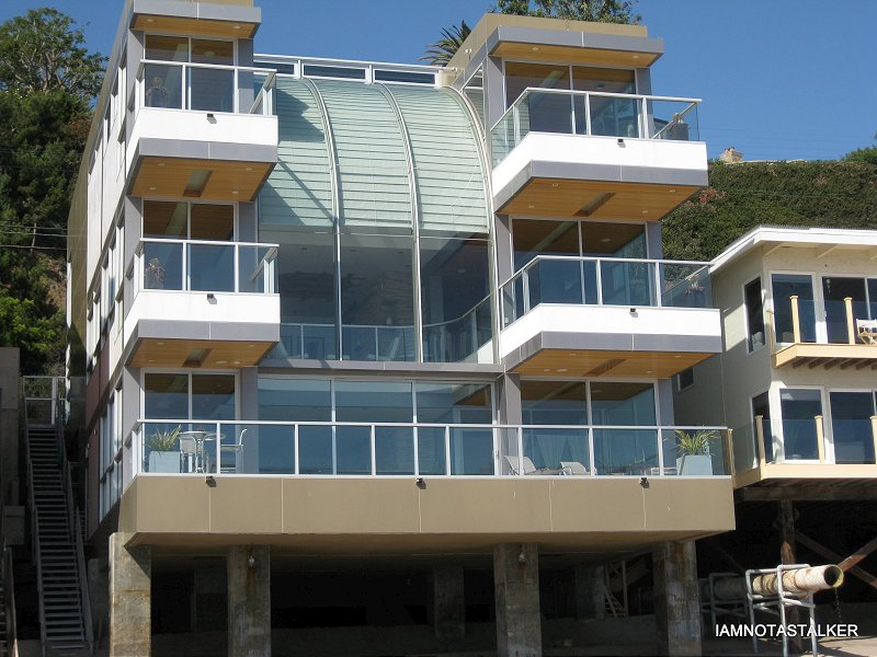Amazing The Beach House Movie Part - 11: In Person, The House Is Absolutely Breathtaking. Located Right On The Sand  In Malibu, The Home Has Five Separate Cantilevered Balconies That Seem To  Just ...